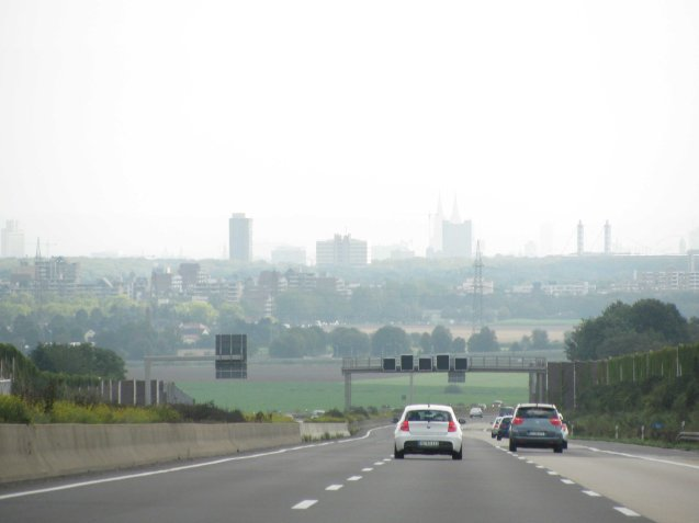 Approaching Cologne in September 2011, the twin spires of the city's famous cathedral visible through - we think - early morning haze.