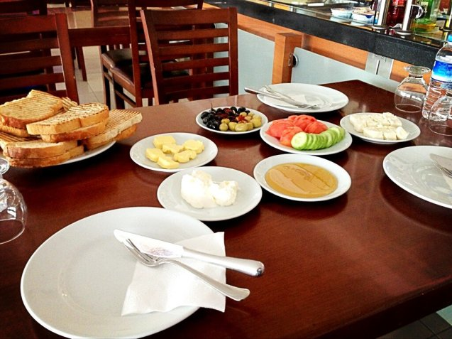 A 6am meant that by daybreak it was time for breakfast at a service station: olives, white cheese, salad, honey and kaymak (clotted cream).