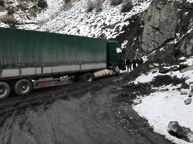 A lorry gets stuck at the entrance to the Istiqlol Tunnel, known locally as the Anzob Tunnel or the 'Tunnel of Death'. Three miles long, 50 miles north west of Dushanbe. Opened in 2007. Built and financed mainly by Iran.