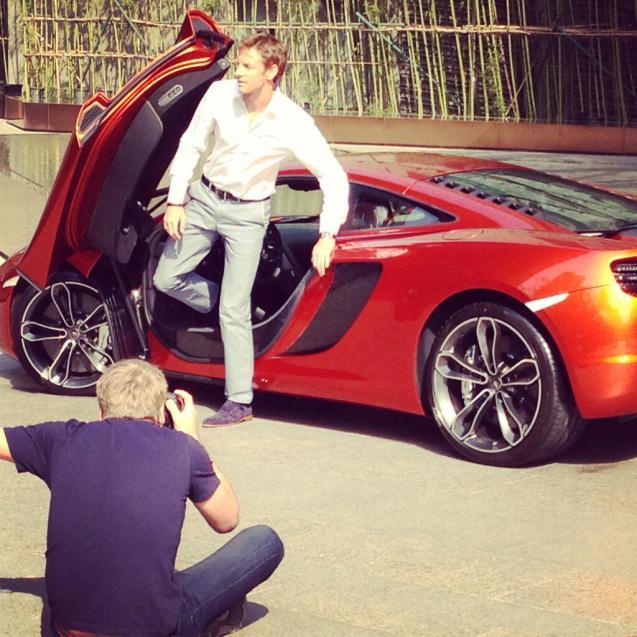 Jenson Button filing a comerical for Vodafone McLaren Mercedes F1 team sponsor Johnny Walker.
