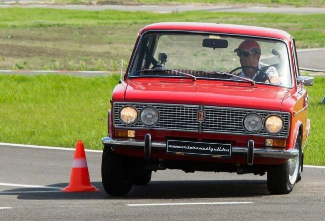 Lada and I showing the cone who's boss at a Vodafone safe driving event today in Hungary - @JensonButton