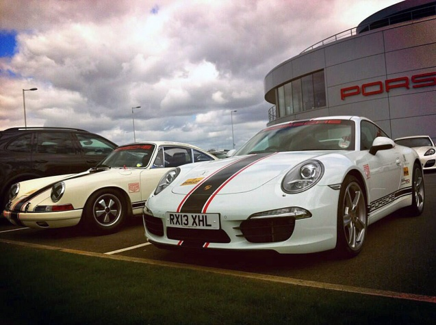 The 1965 Project50 racing 911 alongside a modern 991 in the same livery. Project50 has been built to celebrate the 911's 50th birthday in September. Photo: Twitter/ PorscheGB_PR