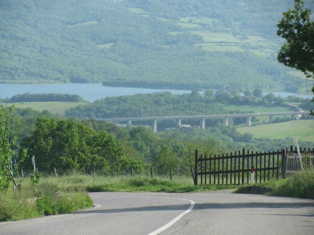 Random pic: A great road - SP65 Raticosa Pass - countryside - Tuscany - lake - Lago di Bilancino - and some impressive infrastructure. We're happy.