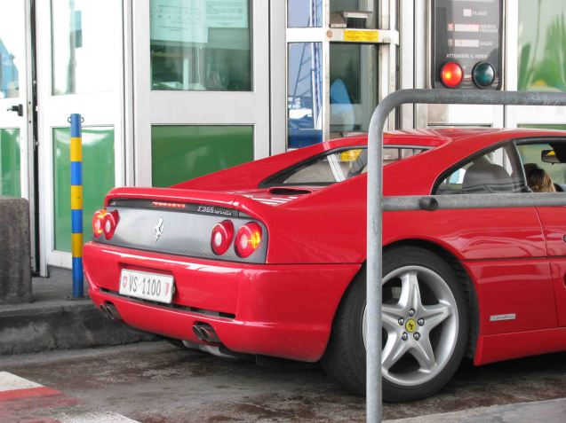 Italy: Even Ferrari owners have to scrabble around for change.