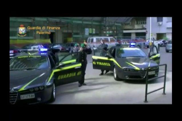 Guardia di Finanza officers on a raid in Palermo.