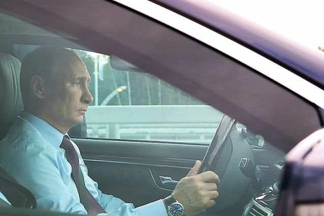 Vladimir Putin driving himself to the opening ceremony of a new section of the trans-St Petersburg Western High-Speed Diameter road yesterday. Two of the three sections are now open to traffic. The road through-passes the historic city centre. Putin used the opportunity to make it clear Russia is open to foreign investment in the next stages of its infrastructure plans which include a new ring road around Moscow. a