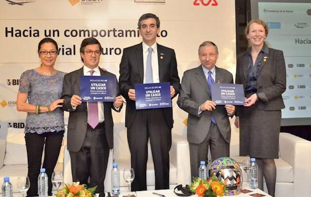 FIA president Jean Todt, second from right, presenting a road safety award in Argentina.