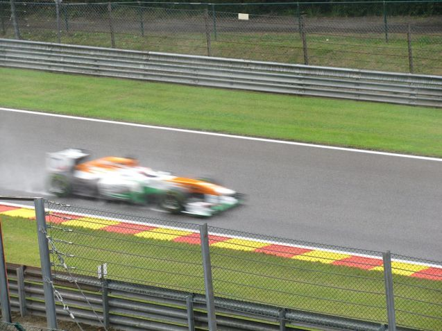 A Force India on the way in to the fearsome, spectacular, fantastic, flat out double left hander at Pouhon.