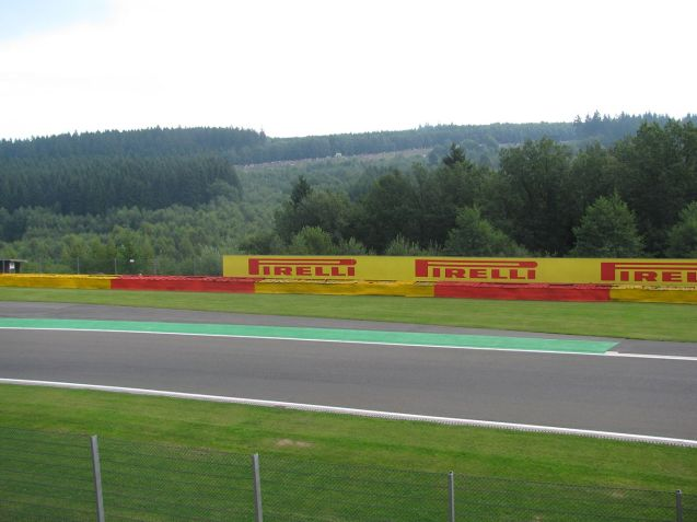 The kerb on the inside of Blanchimont with Kemmel in the distance. If they fly up there fast that's nothing compared to Blanchimont where they flit past you eyes so fast it's hilarious. You have to see it, but it's a shame there's no grandstand on the outside where you could see the cars