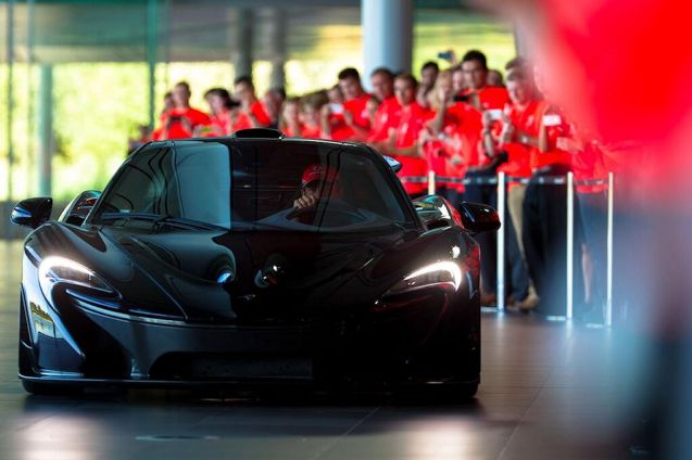 A late pic from McLaren's 50th birthday celebrations at its Woking factory yesterday. Jenson Button driving the increasingly gorgeous P1.