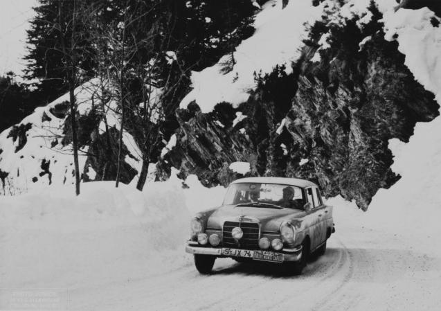 "Baroness Ewy Rosqvist and Ursula Worth winning the Ladies' Cup at the 1963 Monte Carlo Rally in a Mercedes Benz 220SE. This was when the event really was a Rally. Competitors started from one of seven cities – Stockholm, Paris, Glasgow, Lisbon, Frankfurt, Warsaw, Athens – and 'rallied' in Monte Carlo. History records there were 341 entries that year, 296 starters and 102 finishers. Rosqvist and Worth came 16th overall. Thirteen crews started from Athens but they were unable to reach Belgrade because of snow. Another Mercedes driver, H.Felder, stopped to help Rosemary Smith and Rosemary Seers who had rolled their Sunbeam Rapier into a ditch ""while not wearing seatbelts"" but lost so much time he retired too. Patricia Ozanne crashed her Mini Cooper into a lorry on the M1."