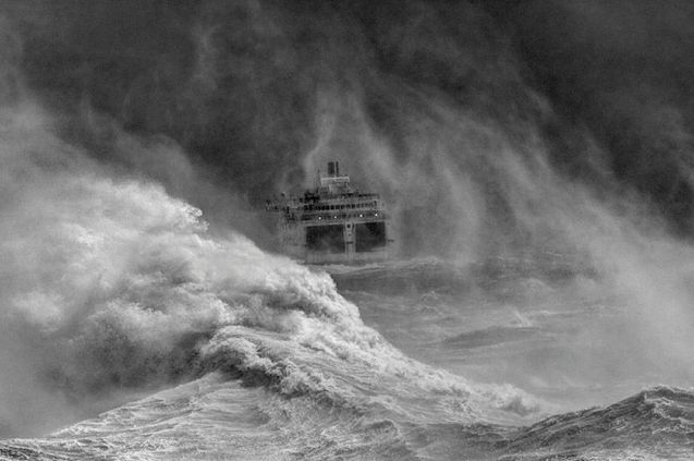 Ferry leaving Newhaven harbour in storm, East Sussex, England by David Lyon.