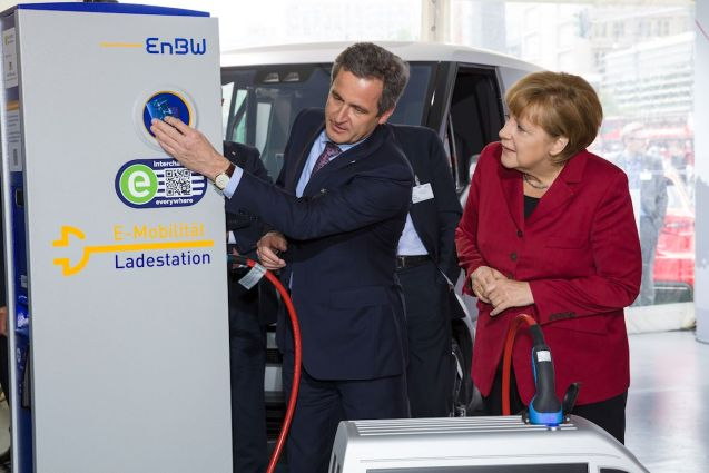 Mutti fakes interest in the 'interchange everywhere' system at an earlier event in Berlin.