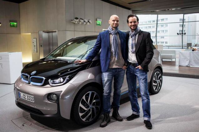 Early adopters. The first BMW i3 electric cars hit the road today. The company held a special event at its Munich headquarters last night (above) where six customers got their keys a day ahead of everybody else. BMW is bullishly confident the i3 will turn out to be a huge success. Executives were considering increasing the first year's production run of 8,000 cars because demand has been so strong. Auto Express reported yesterday that 200 i3s are so far heading for the UK, half of them the range extender version with a small petrol engine to supplement the electric motor. Pic via @Sycamore_BMWi Peterborough.