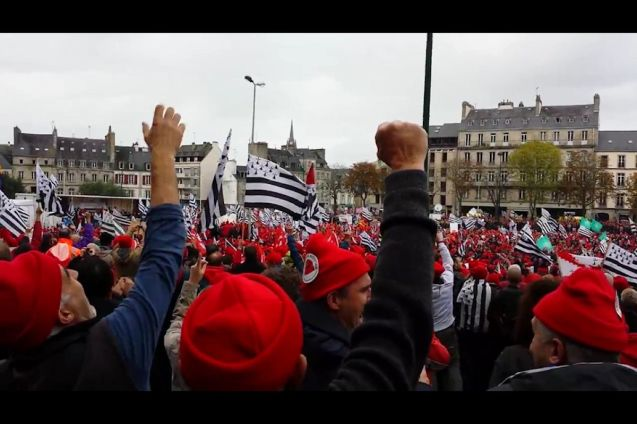 Thousands of red hatted protstors - Les Bonnets Rouge, recalling a 17th century tax revolt against Louis XIV - took to central