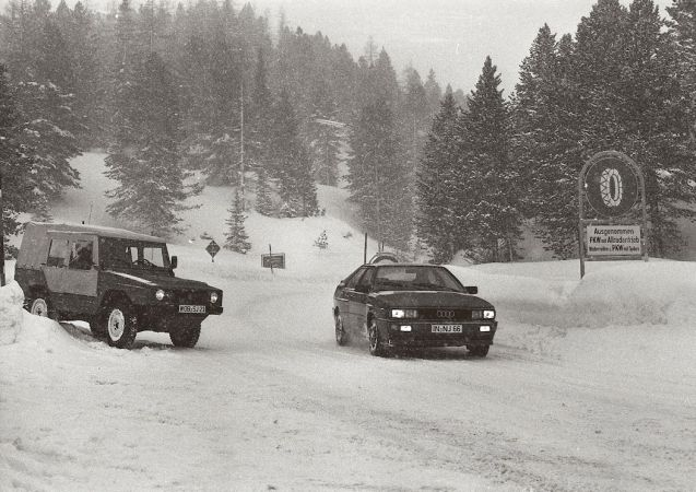 In January 1978, Audi engineers demonstrated a revolutionary idea in front of the company's board of directors: a four wheel drive road car. Previously the preserve of cumbersome all-terrain vehicles - indeed it was the way the 75bhp Iltis military vehicle embarrassed high powered road cars on a previous test in Sweden that sparked the idea in the first place - the way the quattro dealt with the fearsome snow covered Turracherhohe convinced everybody that four wheel drive was the way to go.