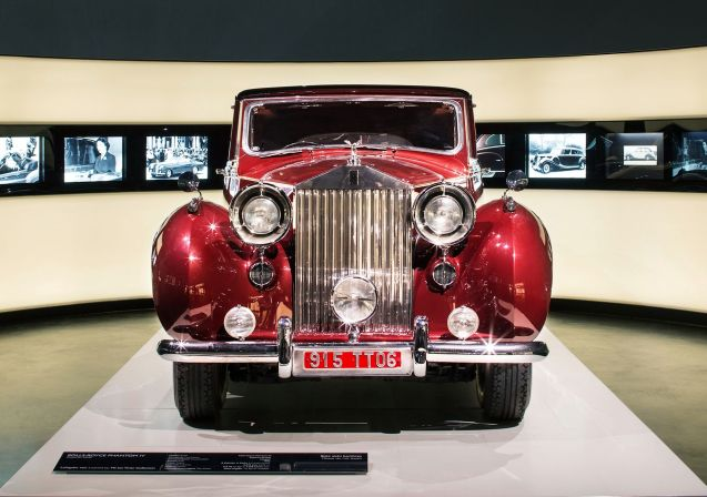 Former tennis player Ion Tiriac, now owner of the biggest chain of car dealerships in Romania, and one of the country's richest men, puts part of his 250 strong classic car collection on show in Bucharest from 29 November. Probably the most valuable is this 1952 Rolls-Royce Phantom IV, built originally for the Aga Khan on the understanding it wouldn't ever be sold (just 18 Phantom IVs were built, all for heads of state or royalty). Eventually however it ended up ferry hotel guests to and from the airport in Missouri, USA. Its later years have been much happier. Tiriac bought the car at a Pebble Beach auction in 2011 after which it went on display at the BMW Museum in Munich to mark ten years of Rolls-Royce under BMW ownership (above). Sixty five of Tiriac's cars will be on show at any one time, rotated every three months, at a showroom in Otopeni, just north of Bucharest. Other famous marques include Bentley, Mercedes, Morgan and Ferrari. The oldest dates from 1899. More details to follow.
