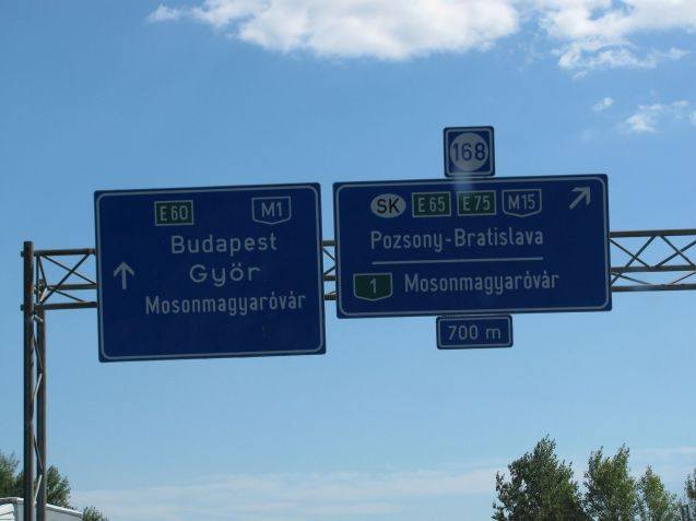 The xxxkm Hungarian M1 links Budapest with the Austrian border via Gyor, the sixth biggest city, pop. 131k, where Audi builds 90% of its engines. This is an early taste of the massively long Hungarian words. Watch out: places in the same area often start with the same letters. In the immediate vicinity of Mosonmagyarovar are Mosonszentjanos, Mosonszolnok, Mosonszentmiklos and Mosonudvar. Not easy to discern at 130kmh.