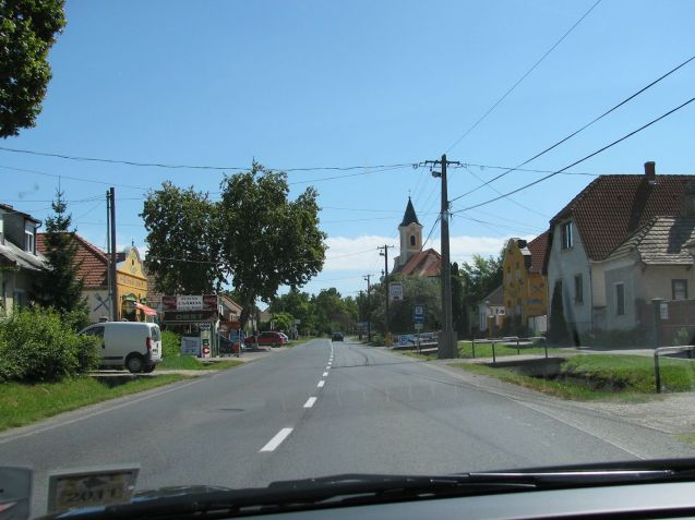 An absolutely typical eastern European village. Trenches each side of the road with concrete bridge driveways to each of the houses.
