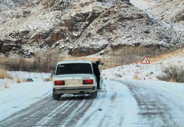 Pole of Cold: the expedition gets a thumbs up from a passing Lada