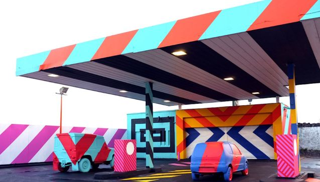 A nod to Ed Ruscha: Irish artist Maser transformed an abandoned petrol station in Limerick, west Ireland, with 'his/her' characteristic bright graphic stripes. Part of a project in the city giving long-term derelict sites to urban art. Maser says, 'I hope to create work that surprises people and questions their relationship with the familiar and the norm.' American pop artist Ruscha famously published a set of bright, graphic photographs called 'Twentysix gasoline stations'. See www.maserart.com