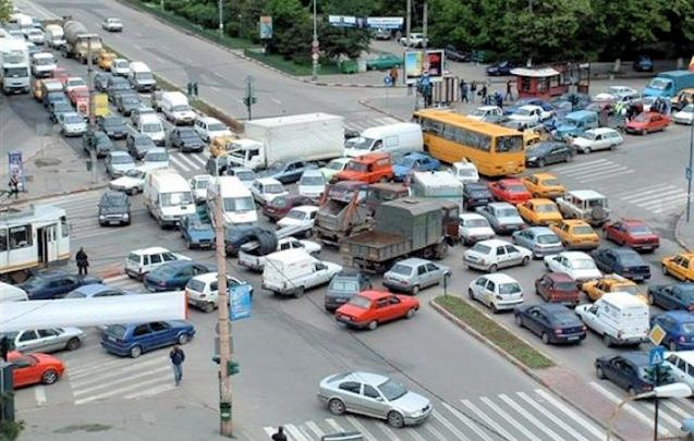 ALBANIA: you have to laugh but, to be fair, there's no date on this classic photo of traffic in capital Tirana. The south west Balkan country is currently struggling with an antiquated road system which varies from absolutely perfect in a few cases to disastrously strewn with massive potholes (according to specialist @DestinationEU). The driving licence system is victim of endemic corruption, the going rate is €100, and many street and road signs have been pinched and sold for scrap. None of this is disputed, even by the authorities. The latest uproar is over a massive sudden hike in insurance fees. High hopes lay on the shoulders of new Prime Minister Edi Rama, elected last September, who has identified modernising the transport system as a top priority. Albania is due to become an EU candidate country in June.