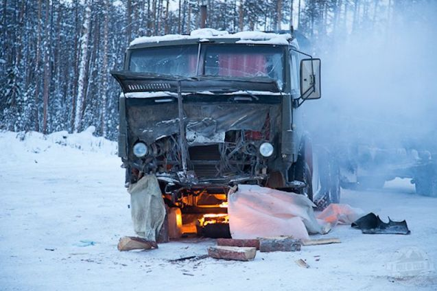 Drivers have had and do have all kinds of ways of keeping themselves and their engines warm. Unsurprisingly, lighting a fire underneath the sump has died out as a practice in Western Europe though it's still common elsewhere. The @PoleOfCold expedition took this picture this week in south east Russia. Keep up with all the action as they prepare to cross into Kazakhstan at www.poleofcold.com. There are still 10,000 unhospitable kilometers to go.