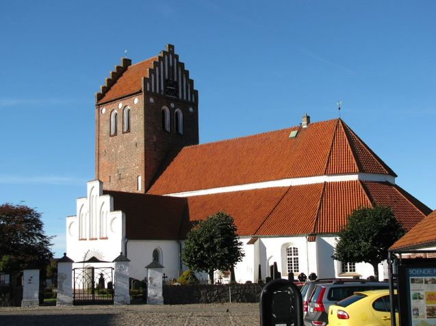 The road into town follows the southern shore of Lakholmsbukten (Laholm's Bay). We stop in the town square beside this church and get a hot dog from the café. Having not actually seen the sea yet we stroll down after lunch to find the most amazing hotel we've ever seen.
