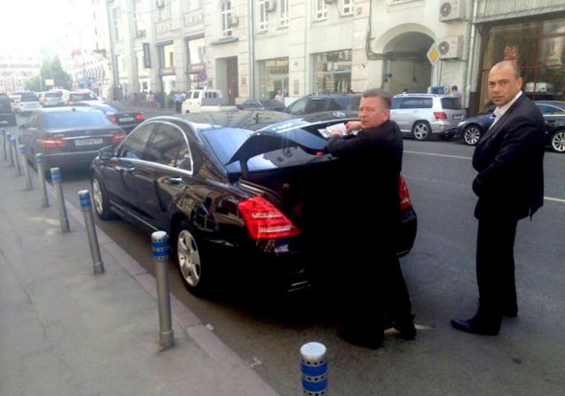 A Moscow limo driver caught in the act sticking a sheet of white paper over the registration plate to avoid parking cameras. It's a great tip, but would you dare?