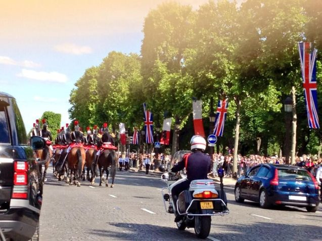 Paris: the unmistakable rear lights of a British Secret Service Range Rover as the Queen's procession makes its way down the Champs Elysee. Photo @HMARicketts, Peter Ricketts, UK Ambassador to France.