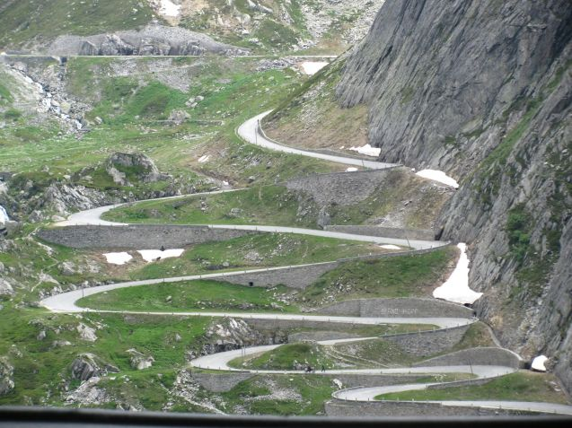 Cobble-paved in parts  and considerably tighter, twistier and steeper than the official Gotthard Pass, Tremola winds its way around the new road, eventually plunging dramatically down the side of Pizzo Centrale (2,999m). To the west is Pizzo Lucendro (2963m) both Lepontine Alps, part of the Western Alps.