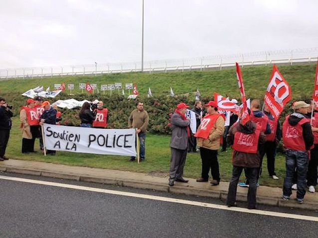 French police gather in Calais to protest over migrant situation this morning.