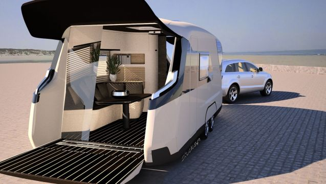 £500,000 for a caravan, are you mad? German manufacturer Knauss Tabbert thinks the cost of its Caravisio 'caravan of the future' concept – unveiled at this week's Motorhome and Caravan Show in Birmingham - is entirely reasonable considering it features finger-print activated biometric security technology, an integral outdoor terrace, wine cellar and king-size double bed within its aerodynamically optimised 9x2.5m fibreglass shell. The reactive glass sliding rear doors double as a cinema screen. Something similar could be on sale in two years says the company but if you offered them half a mil now you could drive it away today (or after the show ends on Sunday).