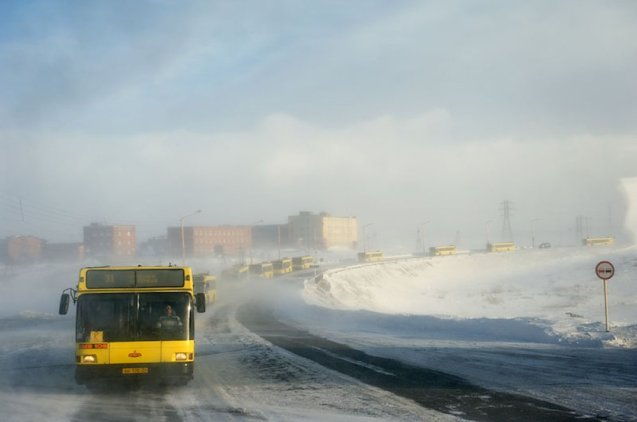 Buses in convoy in Norilsk by Russian/French photographer Elena Chernyshova. More later.