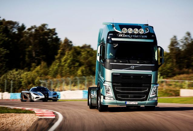 Volvo Trucks races its 540bhp FH against the 1360bhp Koenigsegg One:1 megacar around the Ring Knutstorp in southern Sweden. The idea is to demonstrate the improved 'performance, hill-climb performance, acceleration, but also driveability and comfort' of its new dual-clutch transmission, the world's first truck to be so equipped. Predictably the One:1 wins around the hilly 2km circuit though only just: it has to complete two laps against the FH's one. As presenter Tiff Needell says, 'At least we've proved that the Volvo truck is half as fast as the Koenigsegg One:1.'