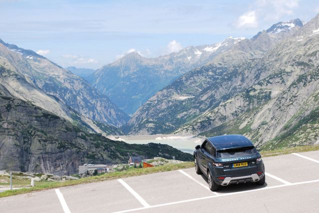 Grimsel Pass: excuse the splats on the roof and the dodgy parking - the driver was given every opportunity to correct it - otherwise this is definitely our best picture of the year, on top of one of Switzerland's most spectacular roads. The otherworldly Albula - also in Switzerland - made it a hard choice but the hairpin ascent, unique grey-green rock, infinite views, massive lake, sinister local goings on (nuclear research), and the intriguing Hospiz hotel meant grimsel is the one we both look back on most fondly. Absolutely breath-taking.