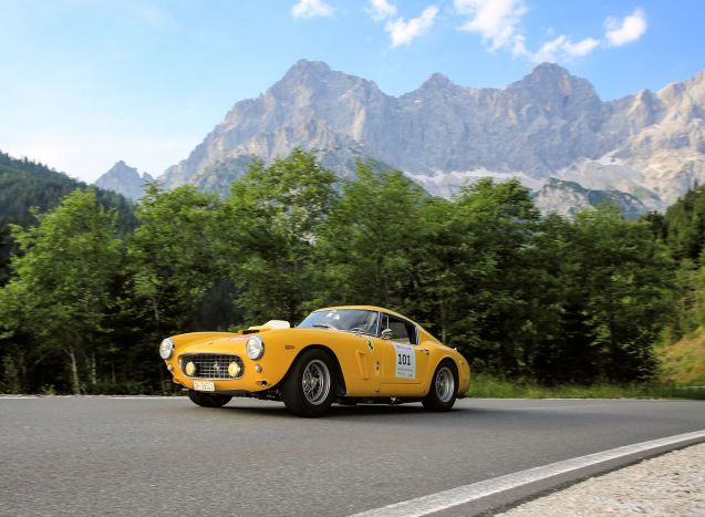 Ennstal Classic 2015, day two: 1961 Ferrari 250 GT Competizione driven by Werner Kummer-Tameling and Gian-Pietro Rossetti from Switzerland along the L711 at Ramsau am Dachstein central Austria against the backdrop of the Dachstein Mountains. Photo © Martin Huber/Ennstal-Classic. See more.