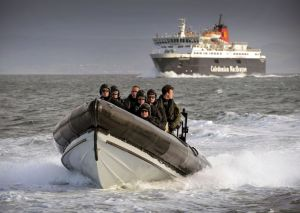Pictured are Royal Marines from 43 Commando Fleet Protection Group, based at HMNB Clyde, conducting underway boarding exercise, in conjunction with the CALMAC Ardrossan Ferry.   The evolution is designed to highlight the work that 43 Commando's Fleet Contingent Troop (FCT) carries out on counter-narcotics and counter-piracy operations around the world. The troop consists of around 30 men, who are the Royal Navy's boarding specialists, trained in enhanced access and entry techniques.