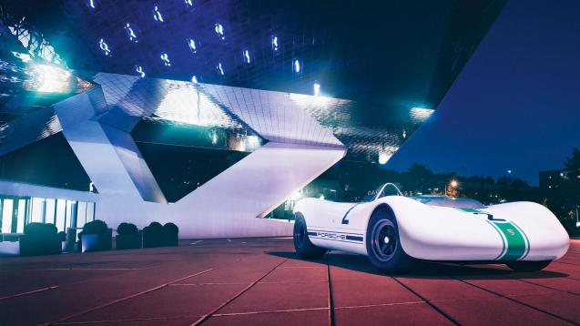 An end of year photo series from Porsche called No night at the museum (1). Various of its historic models are pictured outside Stuttgart's architectural landmarks, including this 909 Bergspyder from 1968 outside the firm's very own Porsche Museum. See more.