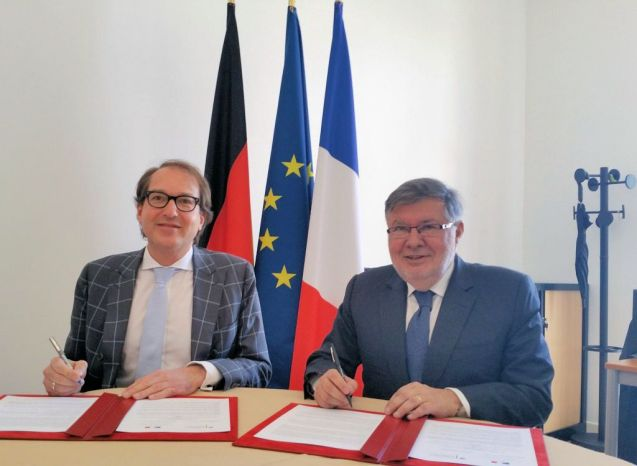 German Transport Minister Alexander Dobrindt, left, and French Transport Minister Alain Vidalies.