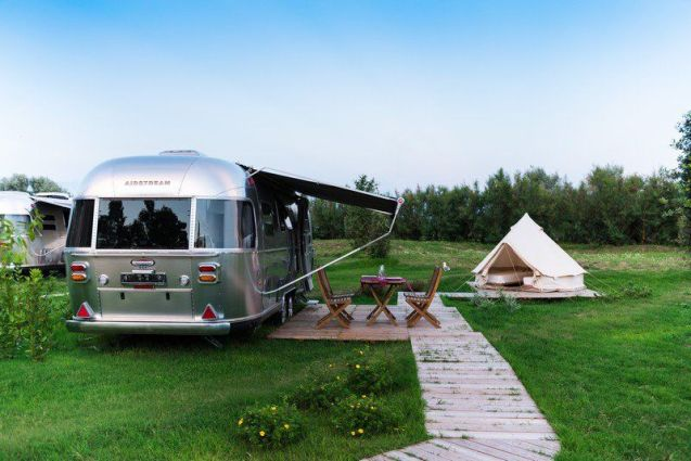 Airstream aluminium caravans start at €72,775 to buy (+ VAT) so it is no surprise that Italy's first holiday park devoted to the iconic American trailer works out a bit pricey too. Even so gobs were smacked to hear the per night prices at Camping Ca' Savio near Venice begin at €125 (and go up to €180). Okay, that includes a tent for the kids, an awning and wooden deck with table and chairs - and bed linen, towels and air conditioning - all 'a few steps' from the beach. But there's a minimum three night stay plus a €45 cleaning charge. Having said all that, the site is just an hour's drive from Venice, or 5km from a water taxi which drops near the Doge's Palace after a 40 minute ride according to Glossy Glamping.