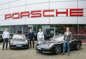 Free parking for Porsches in an interesting venture for the firm's new digital subsidiary. More later.